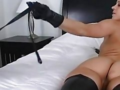 Bootylicious blonde in boots wearing gloves sits on guys face