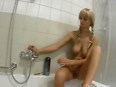 Playful blonde with braids and big boobs strips in bathroom