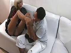 Sexy blonde in stockings and garter belt gets her toe sucked