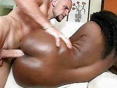 Ebony jumps on a white dick like a mad rabbit