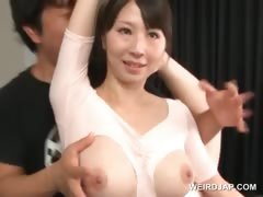 Hot boobed asian gymnast teased in a torn body suit