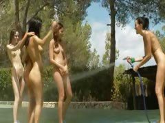 Five naked glamours getting wet outside