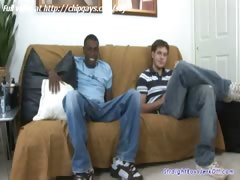 Ebony and white guy sitting on the bed and jerked off