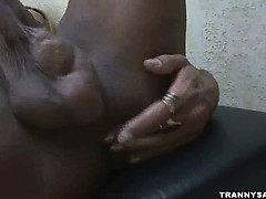 Busty blonde amateur tranny tugging on her cock