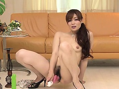 Horny Japanese babe Hitomi Kanou stuffs her pussy with a pink sex toy