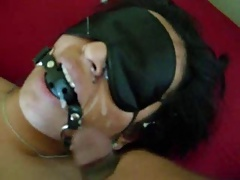 Blindfolded, ball gagged Indian slave takes facial cumshot