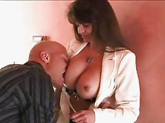 Rockin hot babe June Summers hooking up her mouth with a massive errect cock