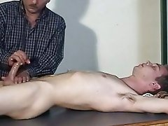 A guy is sleeping while his fellow jerking his cock