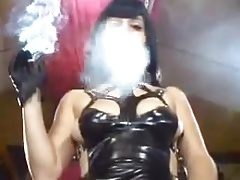 Super hot mistress smokes in her sexy latex dress