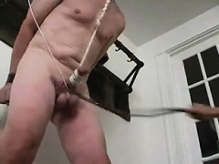 Slave in a mask is tied up and his mistress is whipping his