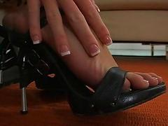 Breasty brunette begins a sexy footjob