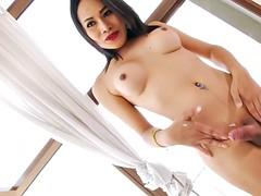horny asian shemale masturbates her cock