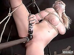 Bound and gagged curvy girl fucked by a big dildo
