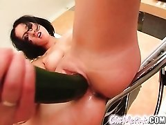 Chick fucks veggie into her shaved pussy