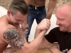 Two blokes and one strong daddy take turns and armwrestle