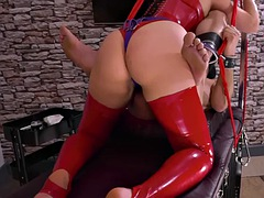Femdom in latex fuck a man with her strapon