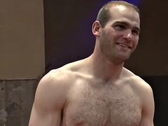 athletic hunk enjoys in wrestling