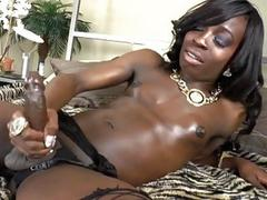 Gorgeous ebony shemale with tiny tits jerks off for us