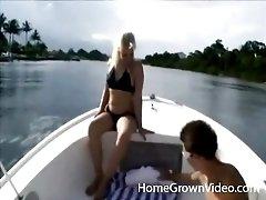 Bikini girl fools around with him on a boat