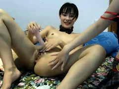 Skinny Asian camgirl with tiny tits fucks her juicy cunt