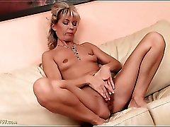 Milf with tiny tits masturbates her pussy