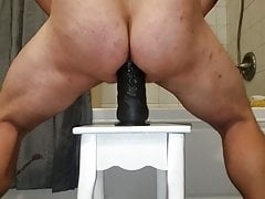 Fucking my ass with a huge black rubber Dick.