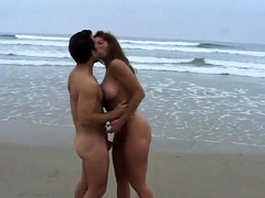 Teen flashing big boobs on windy beach
