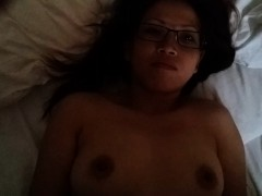 Chubby Oriental housewife lies on the bed and gets facializ