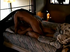 Two attractive studs indulging in a passionate gay romance on the bed