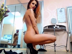 Slender redhead with sexy long legs masturbates on webcam